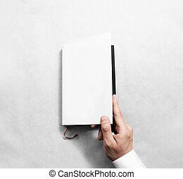 Hand opening blank white book cover mockup template.