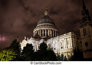 Nighttime view of St Paul's Cathedral with a cloudy sky...