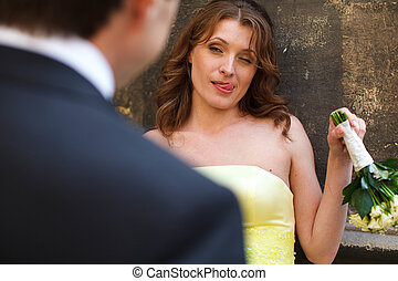 Bride in yellow dress looks sarcastic