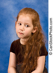 Meditation Portrait of redhead young girl with long hair