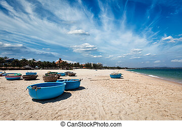 Fishing boats on beach. Mui Ne, Vietnam - Coracle fishing...