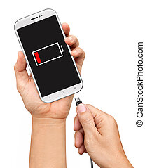 Hand holding smartphone and connect charger isolated on...