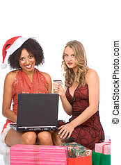Christmas on-line shopping - Two attractive females shopping...