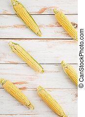 Corncobs on wooden background - Closeup of corncobs on...