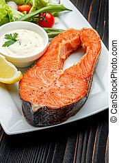 Crispy roasted salmon steak - Studio shot of crispy roasted...