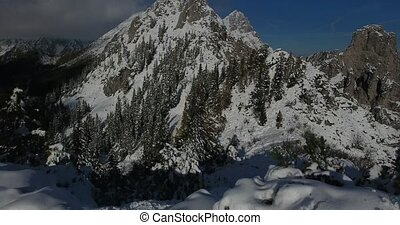 Aerial view of snow covered mountain ridge. Snowman at the...