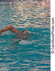 Old Man Swimming Laps in Pool - An older man swimming laps...