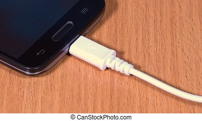 Hand unplug micro usb cable from smart phone. Extreme...
