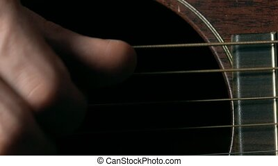 Guitar player's hand over strings. Music performance. 4K...