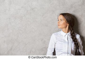 Pretty girl on concrete background - Portrait of pretty...