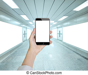 Woman hand holding smart phone in underpass