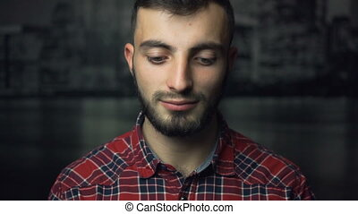 Portrait of Young Man - A studio shot of young man looks...