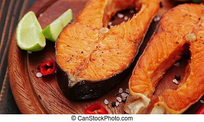 Crispy roasted salmon steak - Studio shot of crispy roasted...