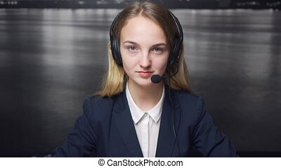 Call Center Operator's Friendly Smile - A studio shot of a...