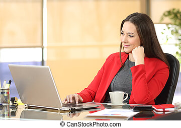 Businesswoman working with a laptop at office - Relaxed...