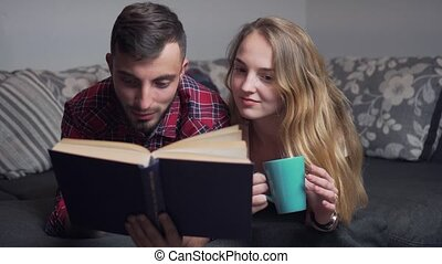 Young Couple Using Tablet and Read the Book