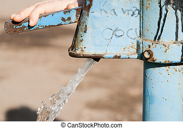 Hand water pump - retro style pumping the water - Hand water...