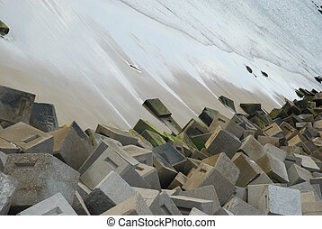 Cubism - Stones scattered on the beach in Cadiz, Spain