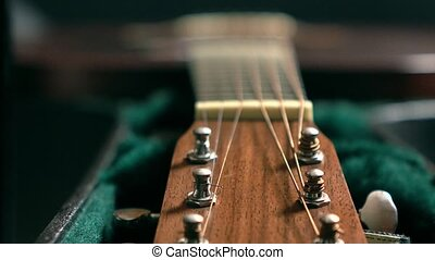 Tuning pegs of acoustic guitar. Tuning or adjustment...