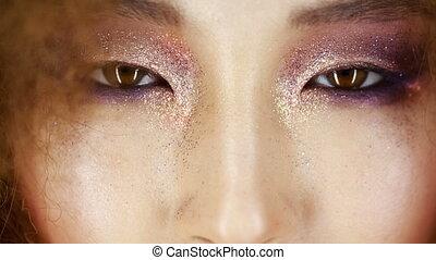 beautiful Asian girl opens her eyes