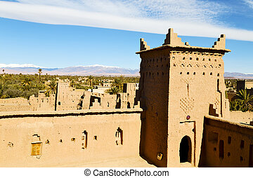 brown tower old construction in africa morocco and clouds...