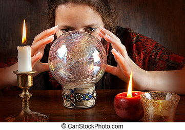 Fortune teller - Young fortune teller in a red scarf working...