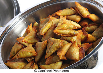 Samosas in a pan These are a popular asian and arab snack at...