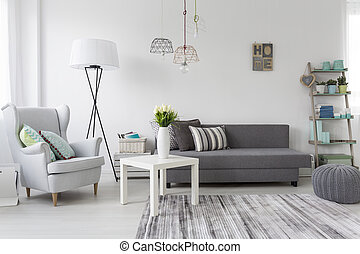 Modern living room interior with a grey armchair