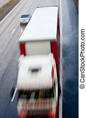 High view of truck and car blurred at speed