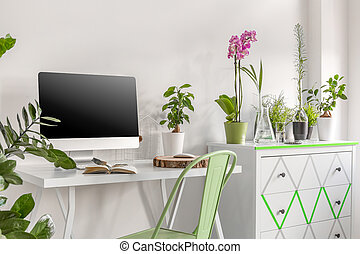 Home office with commode and flowers - Home office area with...