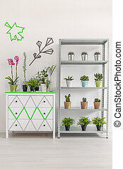 White commode and rack with plants - White commode located...
