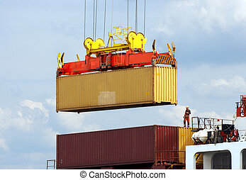 Dockworker on container ship - Dockworker checking the...