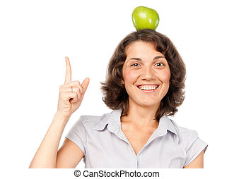 Pretty girl with an apple on her head
