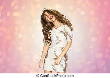 happy young woman or teen girl dancing at party