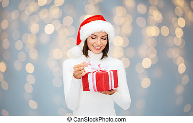 smiling woman in santa helper hat with gift box - christmas,...