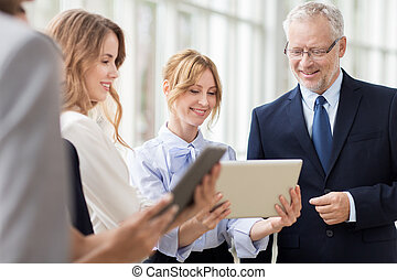 business people with tablet pc computers at office