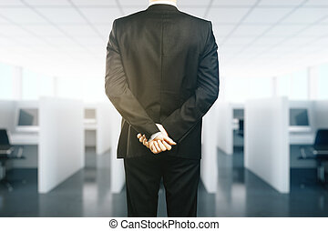Supervision concept - Businessman in suit with crossed hands...
