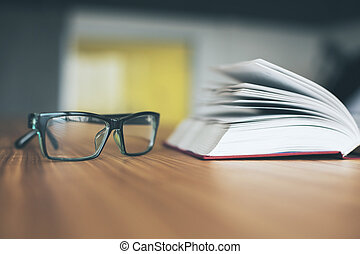 Glasses and open book