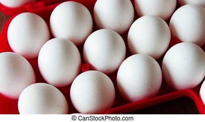 fresh raw eggs in a red tray - Big white fresh raw eggs in a...