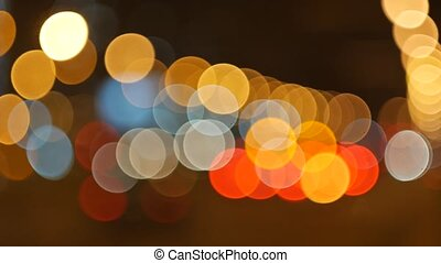 blur background. Moving bokeh circles of night traffic....