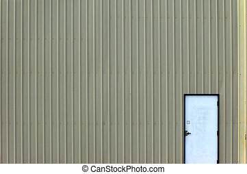 Door to Metal Garage - A metal door that leads into a big...