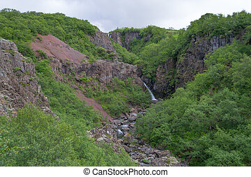Waterfall on the way to the glaier - Tundra landscape in...