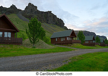 Cabins by the hills in Iceland - Wooden cabins in Iceland