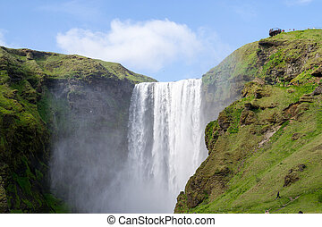 One of the hundreds of wter falls in Iceland - Skogafoss is...