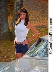 Beautiful Woman Backlit Next to Corvette Stingray - A...