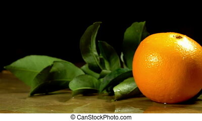 Group of oranges with leaves on wooden boards. - Group of...