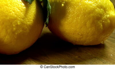 Lemons with leaves on wooden boards. - Lemons with leaves...