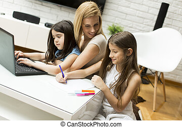 Mother and daughters in the room - Mother and daughter in...