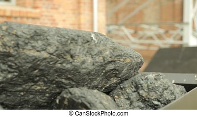Heap of coal in mine cart - Heap of coal in metal mine cart