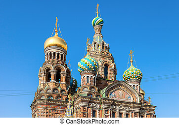 Domes of Church of the Savior on Spilled Blood against blue sky in St. Petersburg, Russia